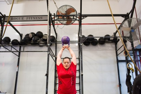 Mary The Trieu works out at a CrossFit gym in New York City. She exercises for many health benefits, but does not emphasize losing weight. PHOTO: ANNABEL CLARK FOR THE WALL STREET JOURNAL