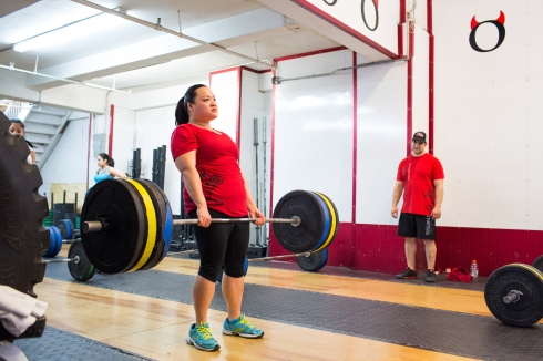 Mary dead lifts 215 lbs at CFHK. Photo Credit: Annabel Clark for The Wall Street Journal.